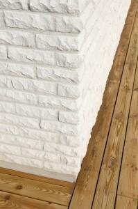 En fasad med rundhugget mexitegel.